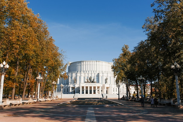 Minsk, belarus. october 2019. opera and ballet theatre surrounded by autumn trees