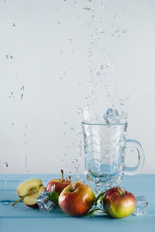 Mint, apples, ice cubes and splashing water.