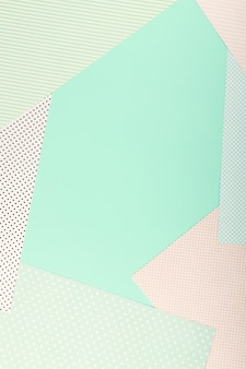 Mint blue and pink pastel color paper geometric flat lay background.