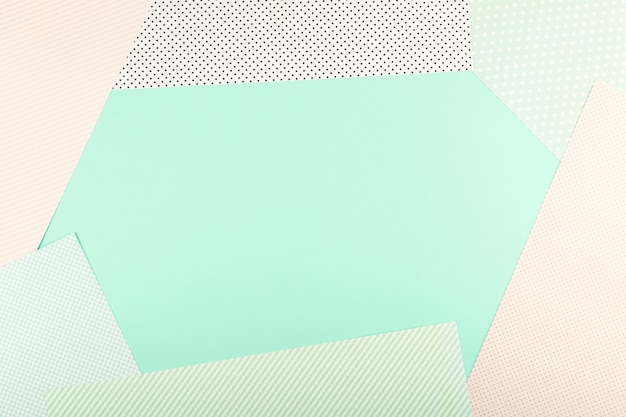 Mint blue and pink pastel color paper geometric flat lay background