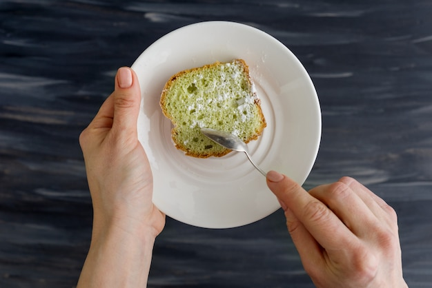 Mint cake on plate in hands