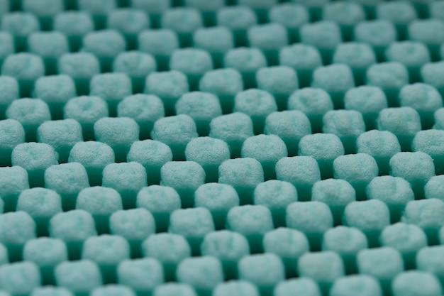 Mint color cleaning doormat or carpet texture