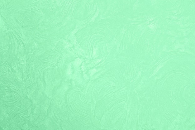 Mint color stucco close-up. plaster wall. interior decor.
