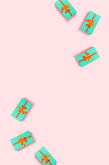 Mint gift box on a pink background.