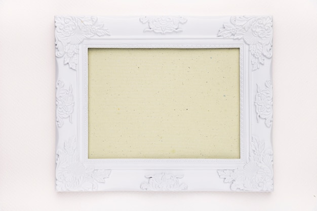 Mint green frame with white floral wooden border isolated on white backdrop