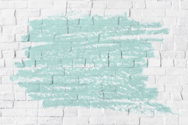 Mint green oil paint texture on a white brick wall
