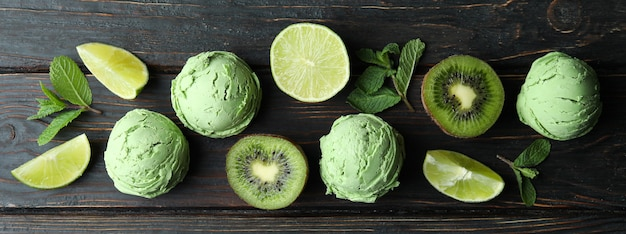 Mint ice cream balls and ingredients on wooden