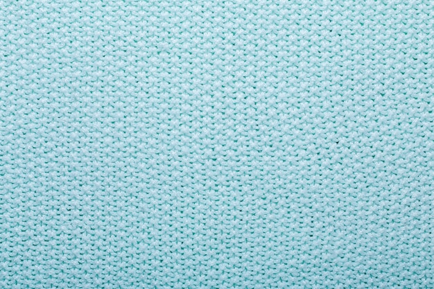 Mint knitting wool texture background crocheted fabric texture top view copy space