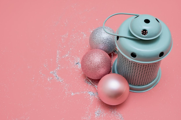 Mint lamp and pink balls. top view christmas flatlay on pink. copy space