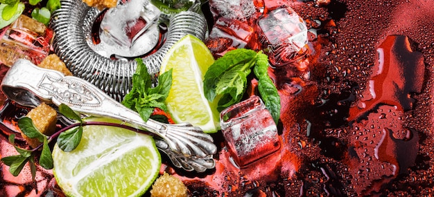 Mint, lime, ice ingredients and bar utensils