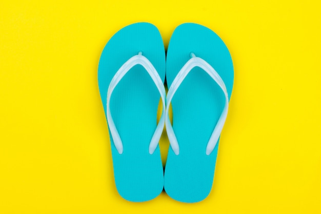 Mint swimming slippers on a yellow background