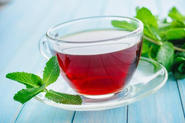 Mint tea n wooden wooden background
