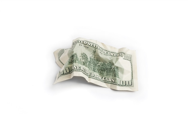 Minted bill of one hundred dollars kind of reverse side on a white background is insulated.