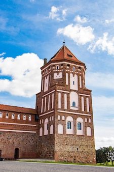 Mir, belarus. view of a medieval castle on a background of blue sky. s