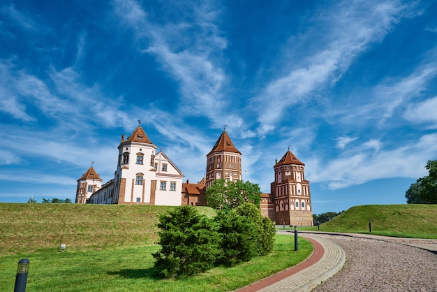 Mir castle complex in summer day with blue cloudy sky