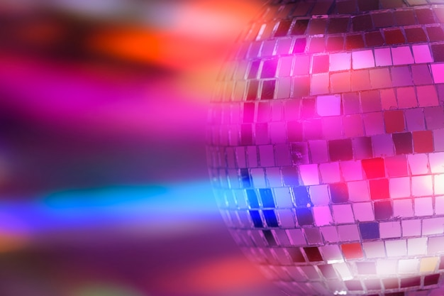 Mirror ball with colorful background. night club. high quality photo