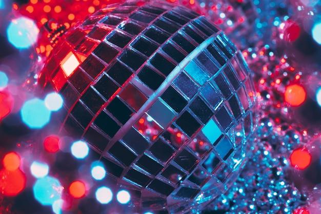 Mirror balls illuminating in the dark close up