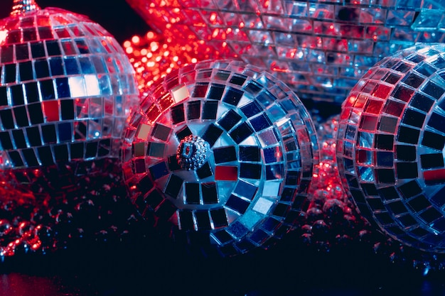 Mirror balls reflecting lights close up, nightlife background