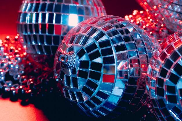 Mirror balls reflecting lights close up, nightlife