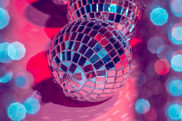 Mirror disco balls over pink . party, nightlife