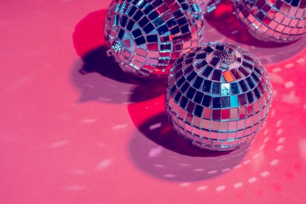 Mirror disco balls over pink