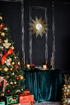 Mirror in the form of the sun . dark wall. christmas tree decoration