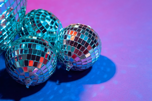 Mirror party balls put on table close up