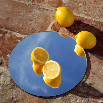 Mirror with fresh lemons