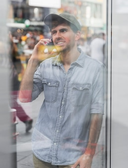 Mirroring image man talking at phone