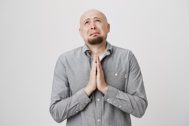 Miserable bald guy supplication, pleading god