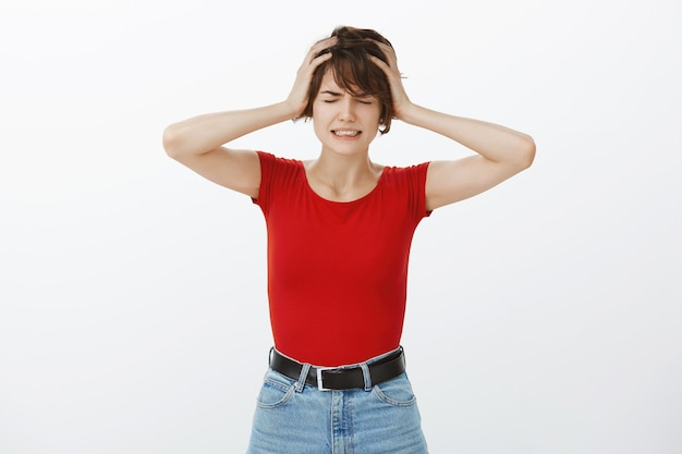 Miserable crying woman having complicated situation, shaking head frustrated