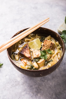 Miso ramen asian noodles soup with tempeh or tempe  in a bowl. . asian style food.