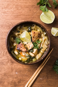 Miso ramen asian noodles soup with tempeh or tempe  in a bowl.