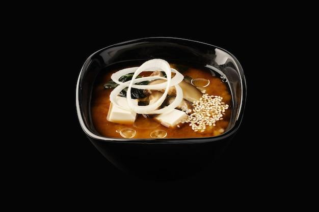 Miso soup, shiitake mushrooms, tofu cheese, wakame seaweed, green onions, leeks, sesame seeds