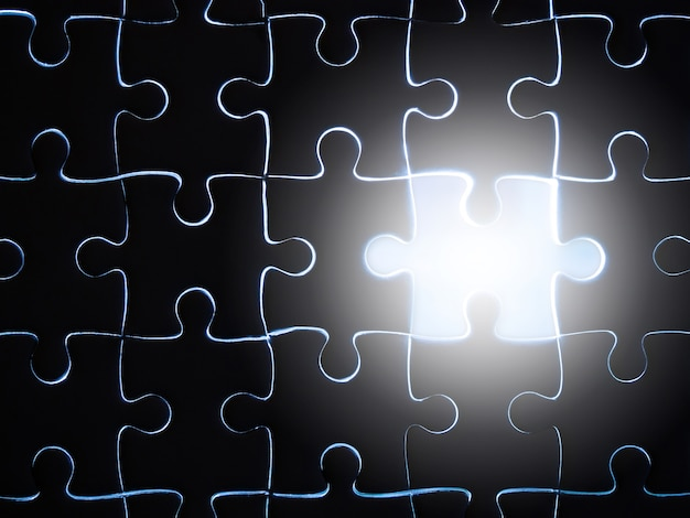 Missing jigsaw puzzle piece with lighting, business concept for completing the finishing puzzle piece.
