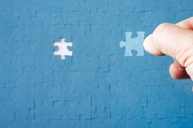Missing jigsaw puzzle pieces. business concept. concept searching a solution for a problem. the missing puzzle. compliting final task. concept of solving a complex problem.