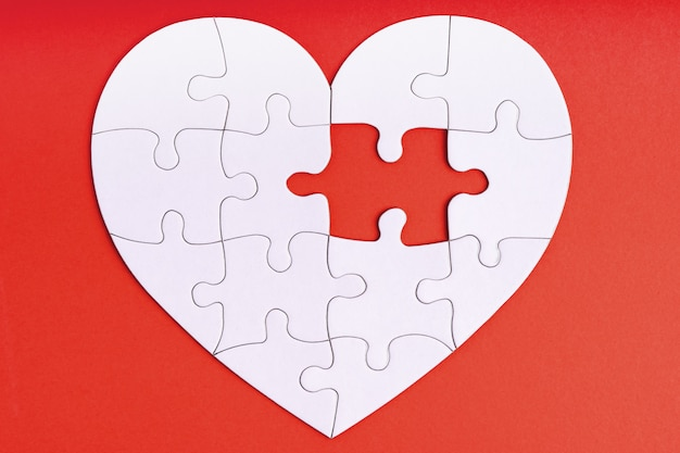 Missing piece of jigsaw puzzle in heart shape