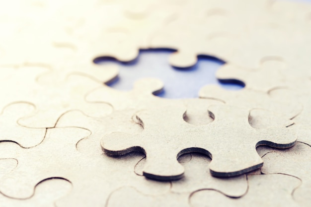 The missing piece of the puzzle. a piece of the puzzle is not in