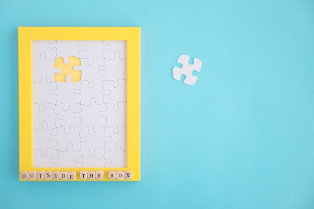 Missing white jigsaw puzzle frame on blue background