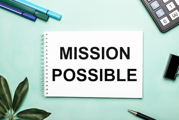 Mission possibleは、文房具とシェフラーシートの近くの青い表面の白いシートに書かれています。アクションの呼び出し
