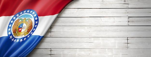 Missouri flag on white wood wall , usa. 3d illustration