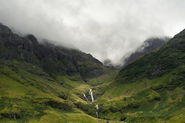 Mist descending on the mountains of scotland during daytime