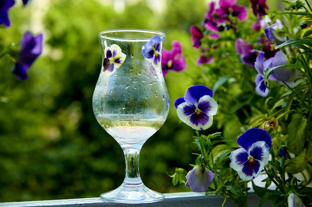 Misted glass on a green veranda with flowers
