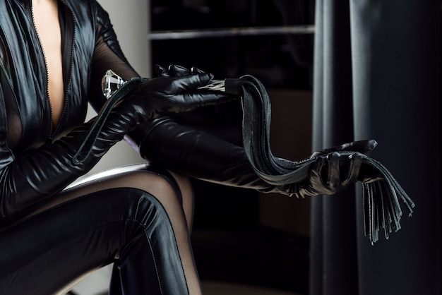 Mistress with a whip in the room