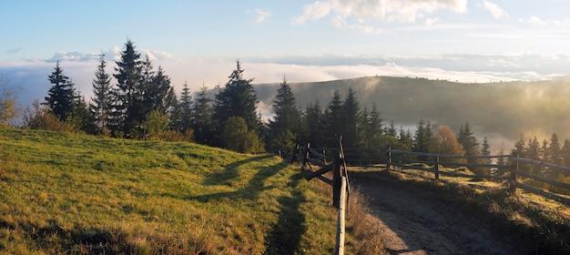 Misty daybreak in autumn carpathian mountain, ukraine. ten shots stitch image.
