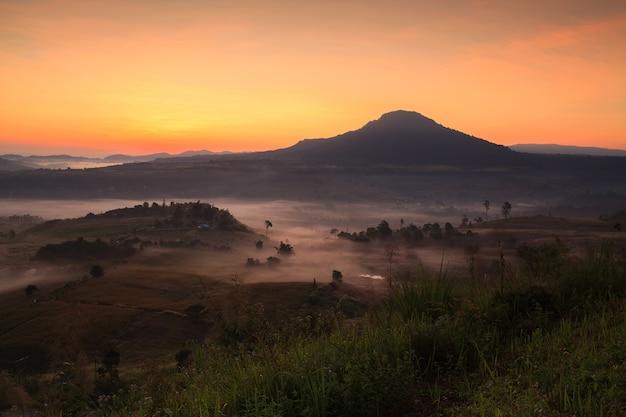 Misty morning sunrise in khao takhian ngo view point at khao-kho phetchabun, thailand