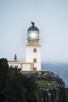 Misty neist point lighthouse at isle of skye, scotland