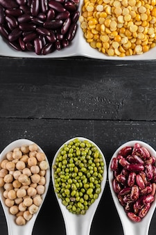 Mix of beans on wooden table
