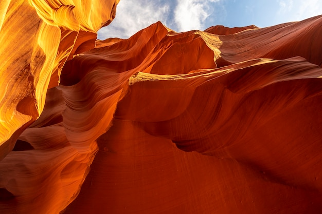 Mix of beautiful orange and red textures in lower antelope and the blue sky above in arizona. united states