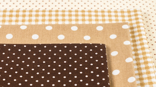 Mix of beige, white and brown cotton fabric. top view.
